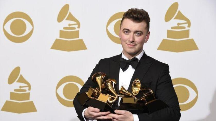 "Sam Smith poses in the press room with the awards for best new artist, best pop vocal album for ""In the Lonely Hour"", song of the year for ""Stay With Me"", and record of the year for ""Stay With Me"" at the 57th annual Grammy Awards at the Staples Center on Sunday, Feb. 8, 2015, in Los Angeles. (Photo by Chris Pizzello/Invision/AP) (/ The Associated Press)"