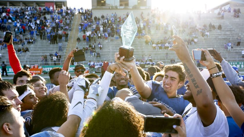 San Diego High (shown celebrating its San Diego Section title last month) defeated Colfax on Saturday for the Cavers' first state football crown.