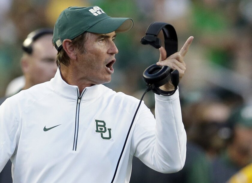 FILE - In this Sept. 12, 2015, file photo, Baylor coach Art Briles yells from the sideline during the first half of an NCAA college football game against Lamar in Waco, Texas. Baylor University's board of regents says it will fire Briles and re-assign university President Kenneth Starr in response
