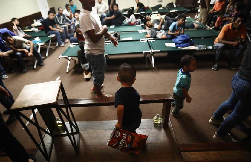 Migrants from Central America gather at a shelter for migrants on May 15, 2019 in El Paso, Texas. Approximately 1,000 migrants per day are being released by authorities in the El Paso sector of the U.S.-Mexico border.