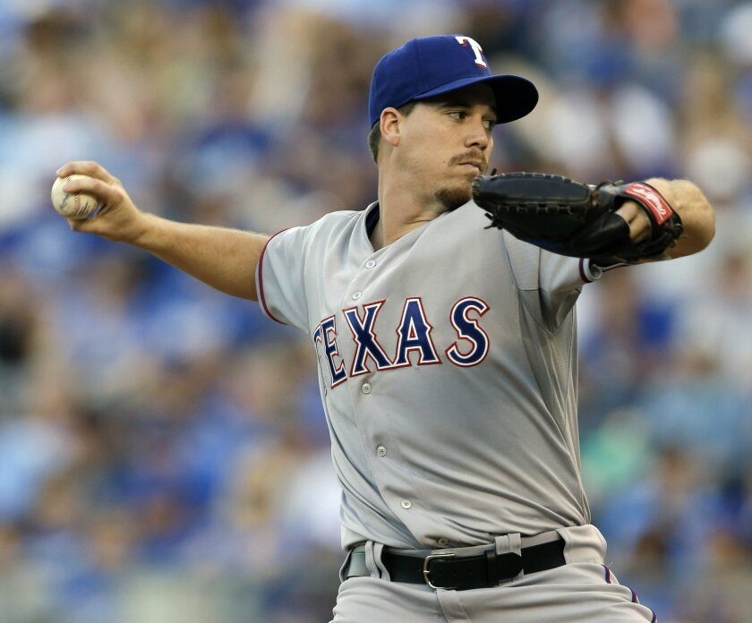 Texas Rangers starting pitcher Chi Chi Gonzalez delivers to a Kansas City Royals batter during the first inning of a baseball game at Kauffman Stadium in Kansas City, Mo., Friday, June 5, 2015. (AP Photo/Orlin Wagner)