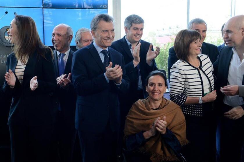 El mandatario argentino, al centro, había recibido amenazas en la Casa de Gobierno.