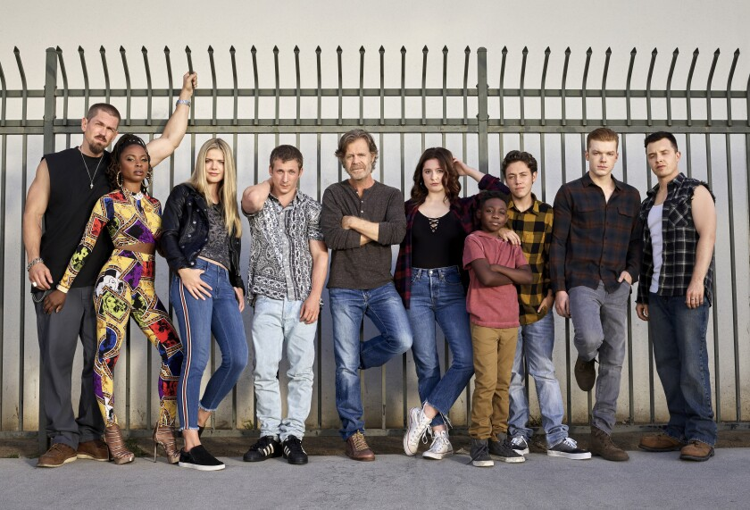 "This image released by Showtime shows cast members from the original series ""Shameless,"" from left, Steve Howey as Kevin Ball, Shanola Hampton as Veronica Fisher, Kate Miner as Tami Tamietti, Jeremy Allen White as Lip Gallagher, William H. Macy as Frank Gallagher, Emma Kenney as Debbie Gallagher, ChristianI Isaiah as Liam Gallagher, Ethan Cutkosky as Carl Gallagher, Cameron Monaghan as Ian Gallagher and Noel Fisher as Mickey Milkovich. Showtime Entertainment President Gary Levine said Monday the series will air its 11th and final season this summer. (Brian Bowen Smith/Showtime via AP)"
