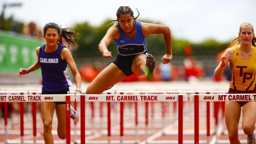 San Diego High's Sonia Redon makes her way to the finish during her victory in the girls 100m hurdles.