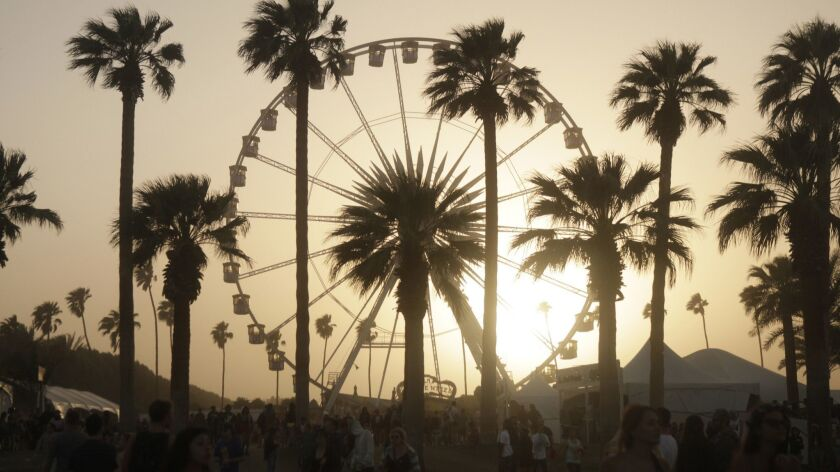 INDIO, CALIF. - APR. 14, 2013. The ferris wheel serves as a backdrop to palm trees on the grounds