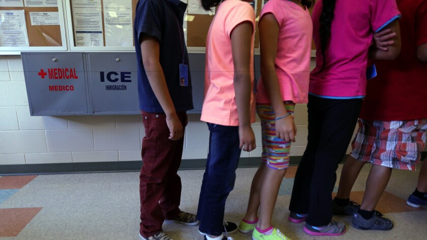 Detained immigrant children line up inside the Karnes County Residential Center, a temporary home for immigrant women and children detained at the border, in Karnes City, Texas in 2014.