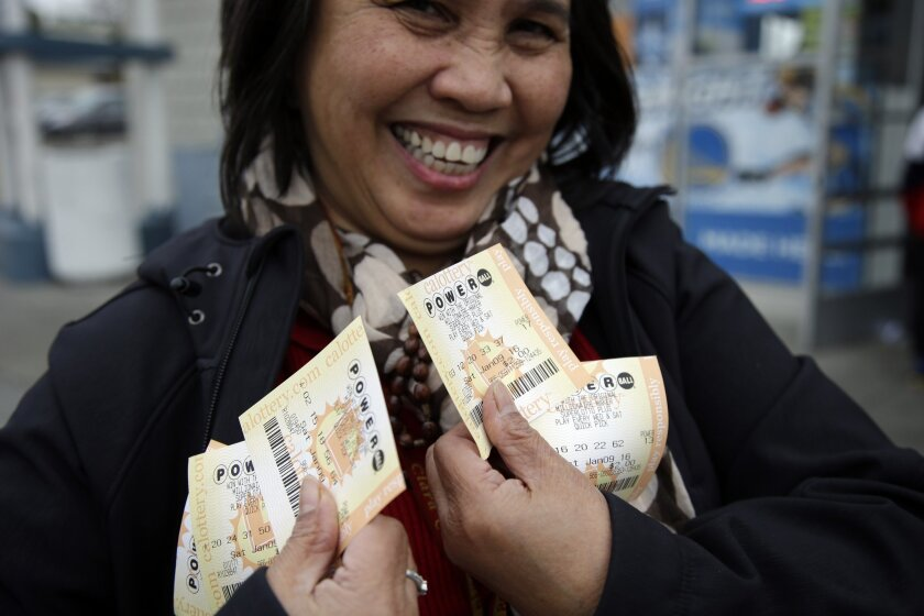 Zaida Cobangbang, of Union City, Calif., shows her Powerball tickets shortly after buying them Saturday in San Lorenzo, Calif.