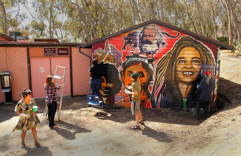 UCSD students and volunteers joined artist Mario Torero at the Che Cafe on Thursday to help touch up murals Torero created in 1993.