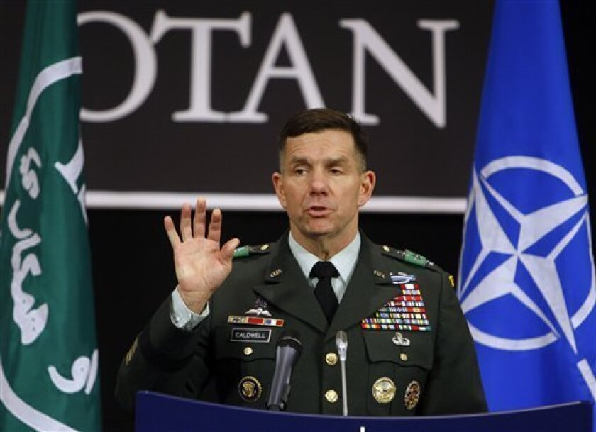 U.S. Army Lieutenant General William Caldwell speaks during a press briefing at NATO headquarters in Brussels, Wednesday March 3, 2010. Caldwell currently serves as the Commander of the NATO Training Mission in Afghanistan. (AP Photo/Virginia Mayo)