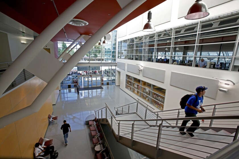 A $25-million library opened on the Compton Community College campus in 2014 after a seven-year delay. Accreditation leaders said the new building was symbolic of the progress the school has made in recent years.