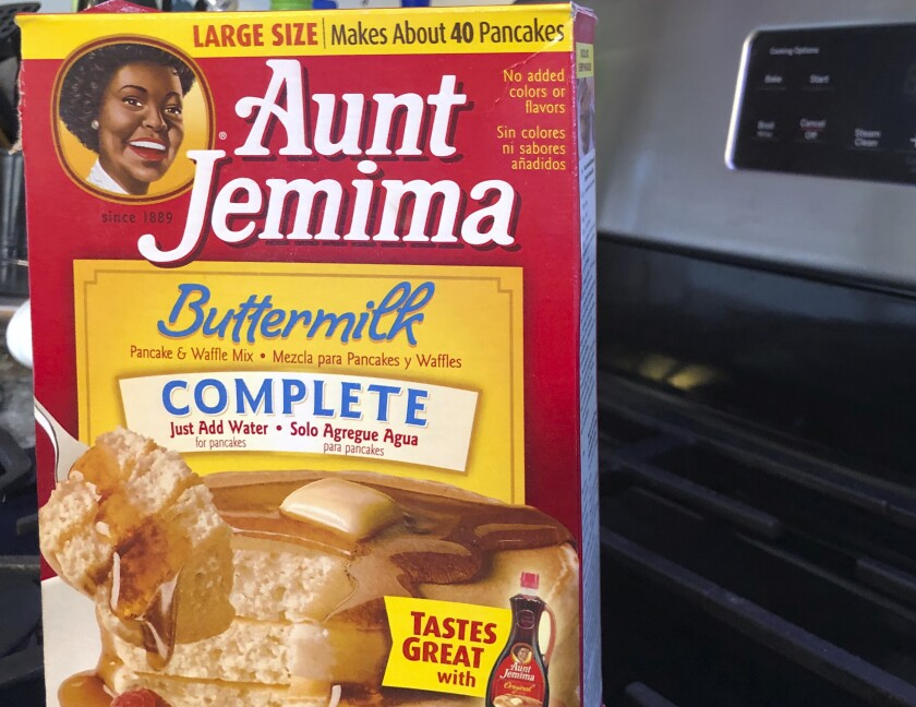 A box of Aunt Jemima pancake mix sits on a stovetop Wednesday, June 17, 2020, in Harrison, N.Y. Pepsico is changing the name and marketing image of its Aunt Jemima pancake mix and syrup, according to media reports. A spokeswoman for Pepsico-owned Quaker Oats Company told AdWeek that it recognized Aunt Jemima's origins are based on a racial stereotype and that the 131-year-old name and image would be replaced on products and advertising by the fourth quarter of 2020. Quaker did not say what the name would be changed to. (AP Photo/Courtney Dittmar)