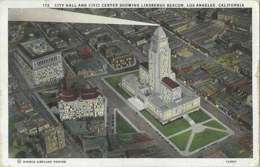 The Lindbergh Beacon shines from Los Angeles City Hall on a vintage postcard