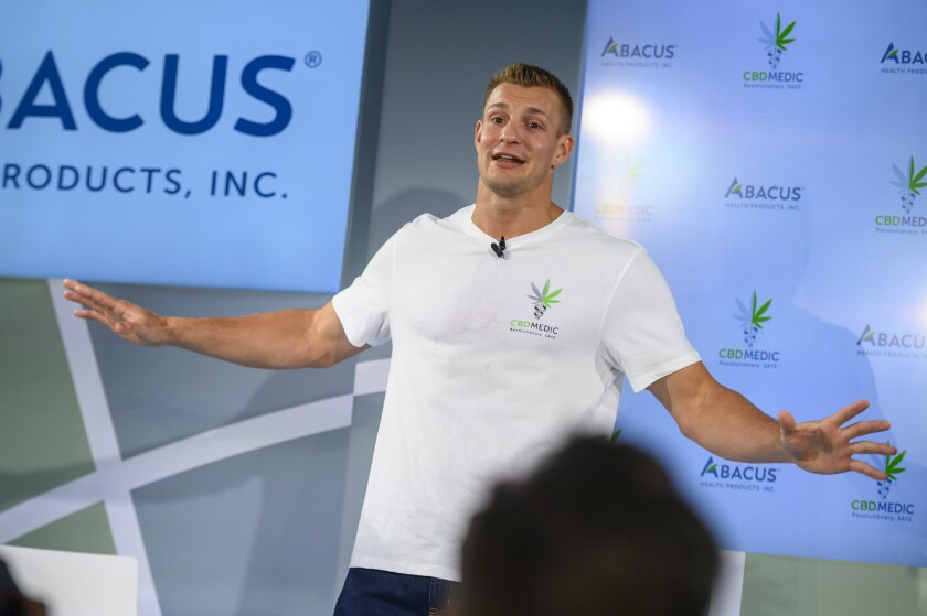Former New England Patriots tight end Rob Gronkowski holds a news conference announcing his advocacy for CBD on Tuesday in New York.