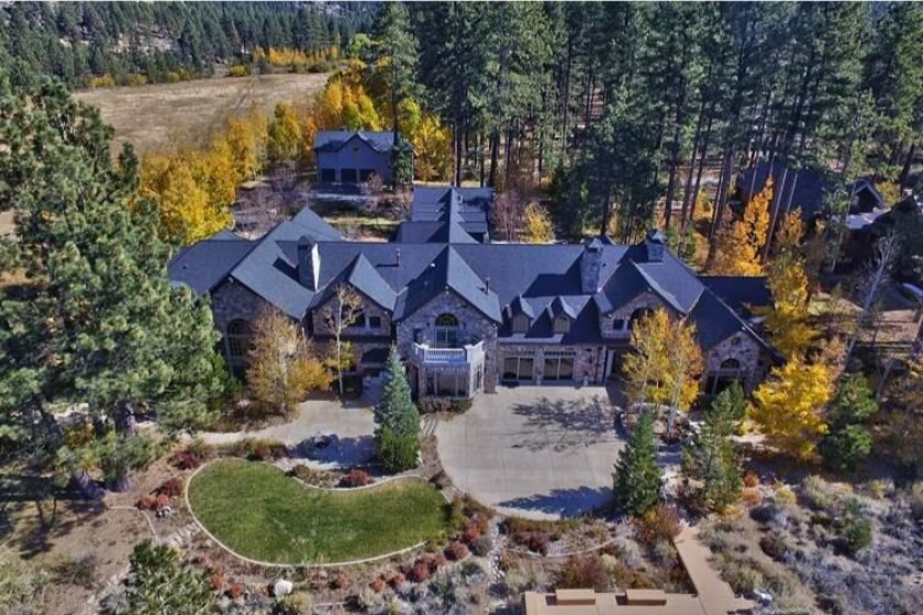 The lakefront estate holds two homes that combine for more than 18,000 square feet.