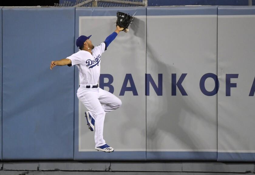 Dodgers center fielder Kristopher Negron can't make a catch.