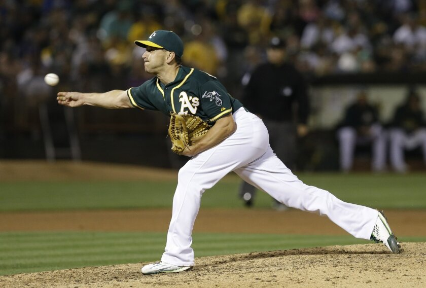 Oakland Athletics pitcher Pat Venditte works against the Los Angeles Dodgers in the seventh inning of a baseball game Tuesday, Aug.18, 2015, in Oakland, Calif. (AP Photo/Ben Margot)