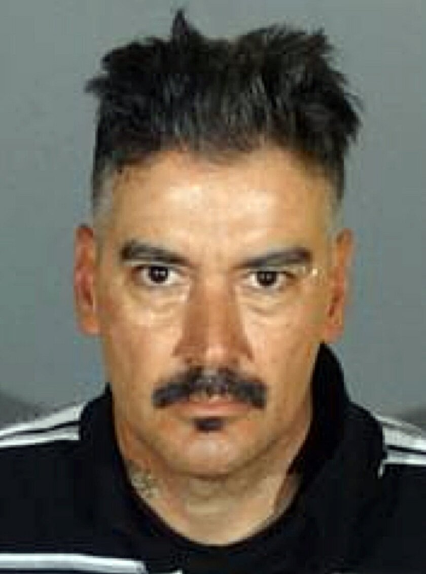 This undated photo provided by the Los Angeles County Sheriff's Department shows Jose Luis Chavez. The Sheriff's Department said Saturday, May 21, 2016, that 47-year-old Chavez is wanted on suspicion of attempted murder of an on-duty officer and is considered armed and dangerous. (Los Angeles Count