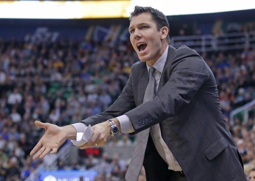 Golden State Warriors interim head coach Luke Walton shouts to his team in the second quarter during an NBA basketball game against the Utah Jazz, Monday, Nov. 30, 2015, in Salt Lake City.  (AP Photo/Rick Bowmer)