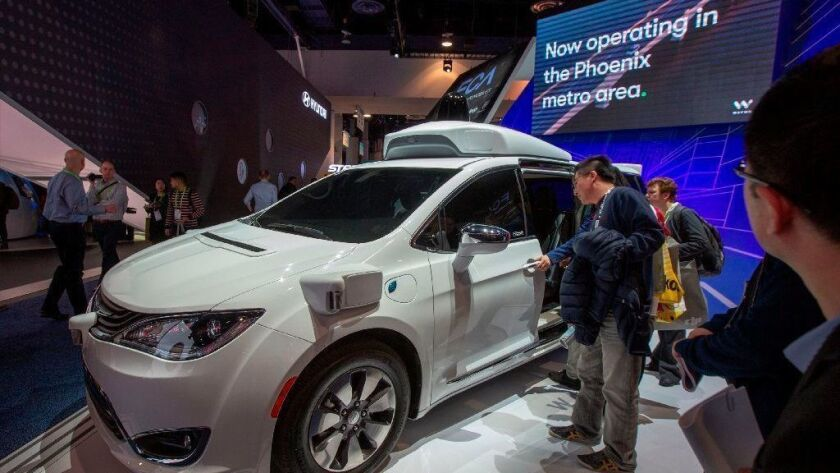 A Waymo self-driving car is seen Jan. 9, 2019, at the Las Vegas Convention Center during CES 2019 in Las Vegas. The autonomous driving spinoff of Google says it will open a factory in the Detroit area.