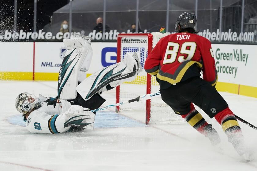 San Jose Sharks goaltender Devan Dubnyk (40) blocks a shot by Vegas Golden Knights right wing Alex Tuch (89) during the second period of an NHL hockey game Monday, March 15, 2021, in Las Vegas. (AP Photo/John Locher)
