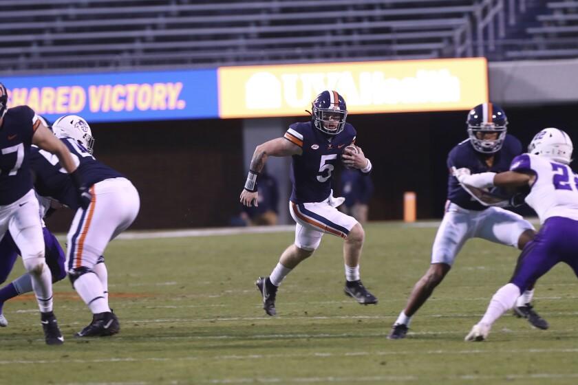 Virginia quarterback Brennan Armstrong (5) runs the ball against Abilene Christian during an NCAA college football game Saturday, Nov. 21, 2020, in Charlottesville, Va. (Erin Edgerton/The Daily Progress via AP)