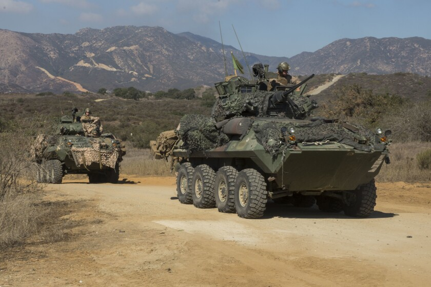 Light armored vehicles (LAV-25s), with 1st Light Armored Reconnaissance Battalion, 1st Marine Division, dr0ve off the range during a field exercise at Marine Corps Base Camp Pendleton in 2016. Marine officials say a similar vehicle was involved in Friday's fatal rollover accident.