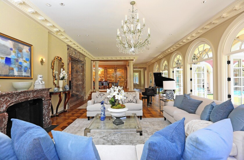 The Italian villa-style home in the 1000 block of Summit Drive was redesigned by Juan Pablo Molyneaux. Ornate details, imported materials and a safe room lined in Kevlar are among features of the 11,000-square-foot home.