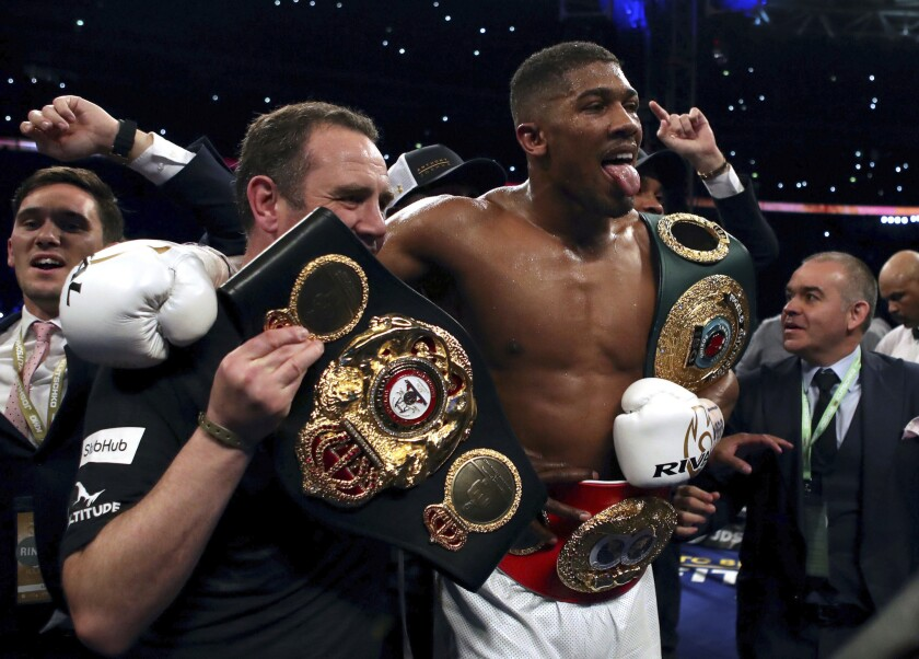 Anthony Joshua of Britain celebrates after defeating Wladimir Klitschko of Ukraine by technical knockout to retain the heavyweight title.