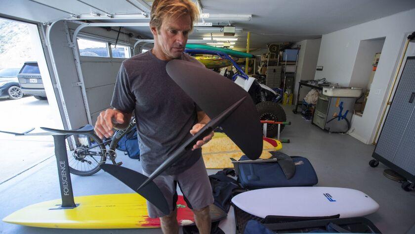 MALIBU, CALIF. -- THURSDAY, MAY 30, 2019: Legendary surfer Laird Hamilton sorts through his foilboar