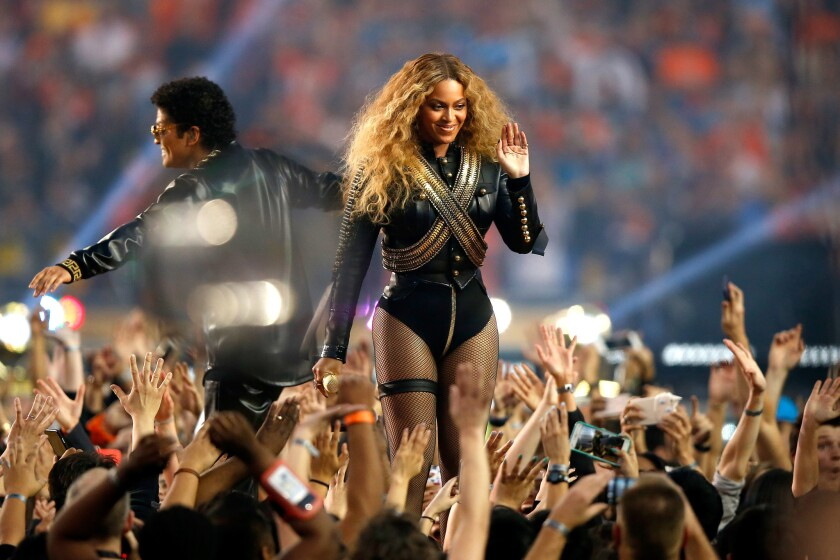 Beyonce and Bruno Mars perform during the Pepsi Super Bowl 50 Halftime Show at Levi's Stadium.