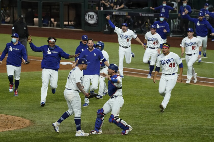 Los Angeles Dodgers celebrate after defeating the Tampa Bay Rays 3-1 to win the baseball World Series in Game 6 Tuesday, Oct. 27, 2020, in Arlington, Texas. (AP Photo/Tony Gutierrez)