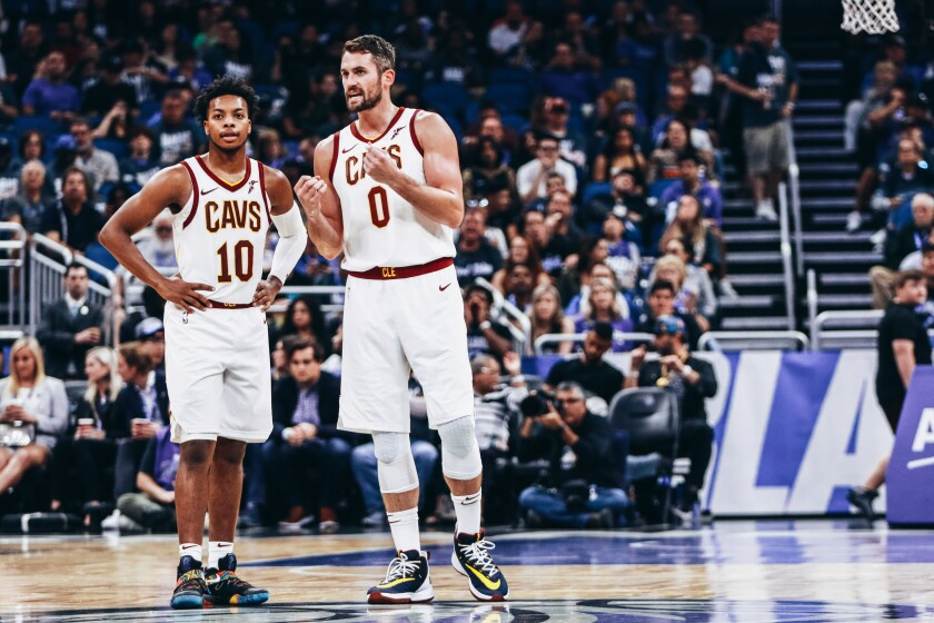Cavaliers forward Kevin Love, 0, talks with rookie guard Darius Garland,10, during a game Oct. 23 against the Magic at Amway Center.