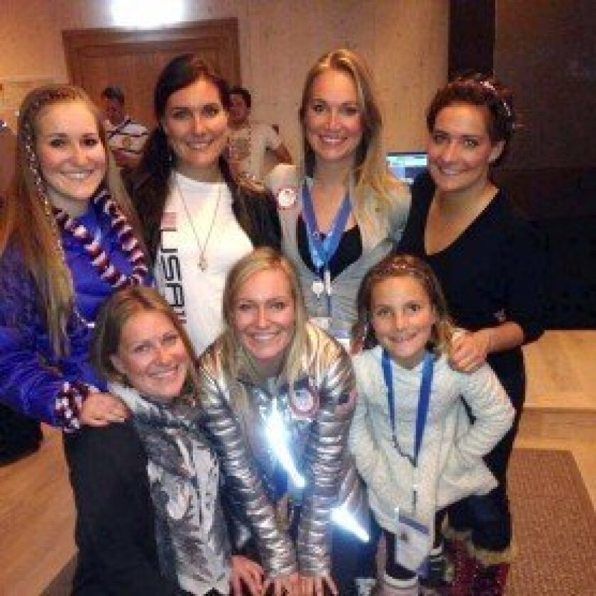 The Anderson sisters in Sochi. Olympian Jamie (bottom center) and Del Mar resident Corrie (second from top left) and her daughter Kenzie (bottom right).