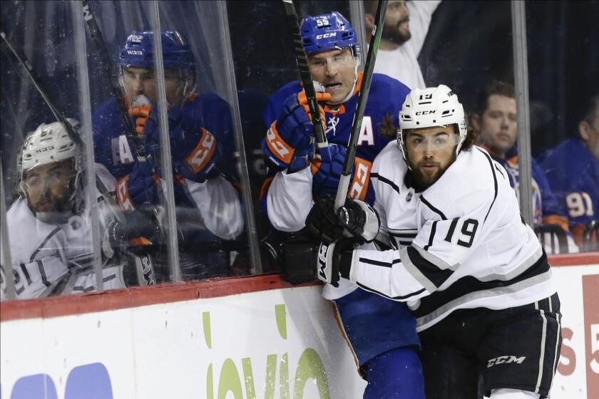 Kings left wing Alex Iafallo checks Islanders defenseman Johnny Boychuk during the first period of a gane Feb. 6 at Barclays Center.