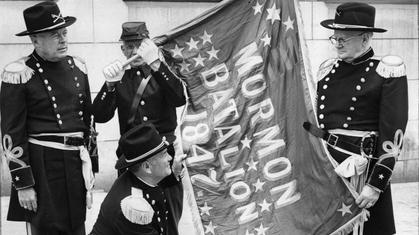 Members of the Mormon Battalion rehearse a ceremony scheduled for July 4, 1956, to mark the raising the July 4, 1847, of the first American Flag on Ft. Moore Hill.