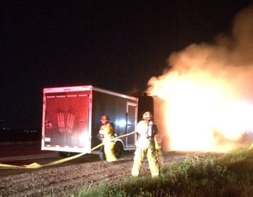 The Rev. Horton Heat tour bus went up in flames north of Oceanside early Wednesday. Members of the rockabilly band made it out safely.