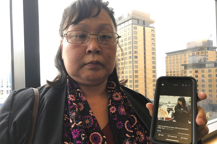 Rena Sapp shows a 2013 photo of her sister, Veronica Abouchuk, who was 52 when her family reported her missing in February.