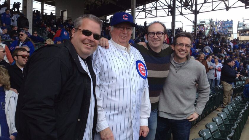 The writer, second from right, with his family -- brother-in-law Jim, from left, father Will and brother Brian, at the 2013 Chicago Cubs home opener.