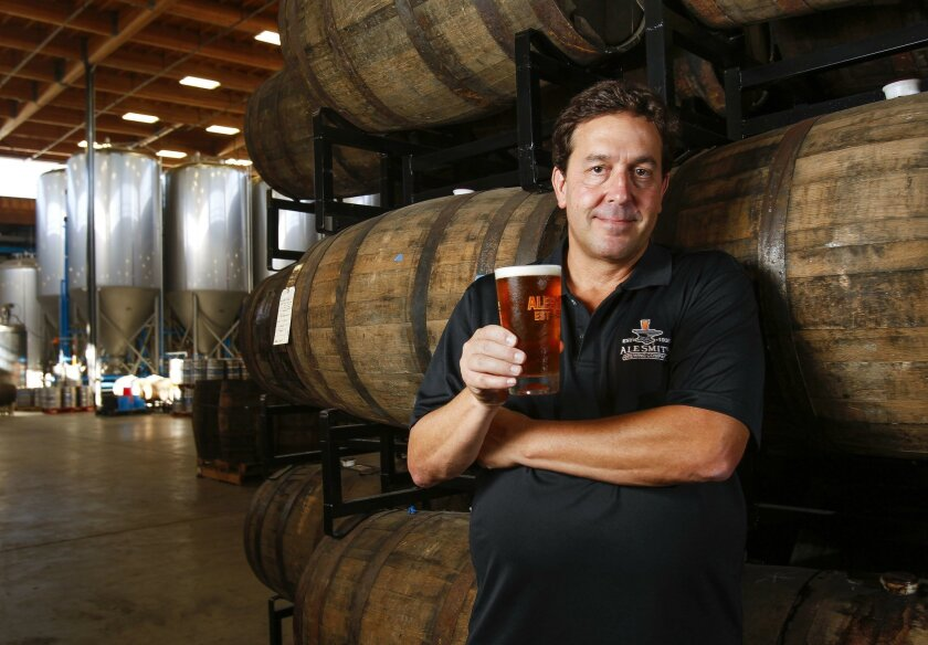 AleSmith Brewing Co. owner and CEO Peter Zien holds a glass of San Diego Pale Ale .394, a beer developed in collaboration with Tony Gwynn.