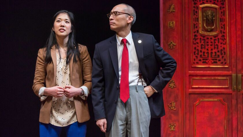 """Stephenie Soohyun Park and Francis Jue in Lauren Yee's play """"King of the Yees"""" at Center Theatre Group's Kirk Douglas Theatre in Culver City."""
