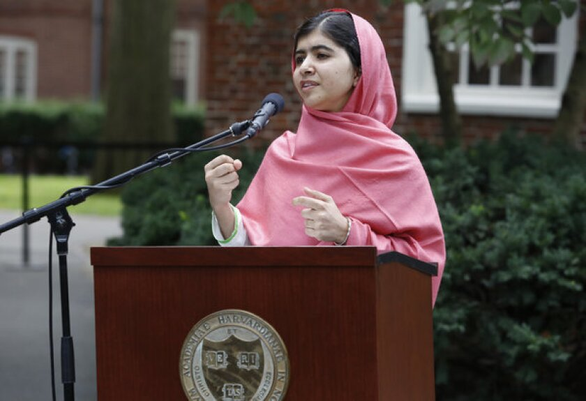 Malala Yousafzai speaks during a news conference at Harvard University.