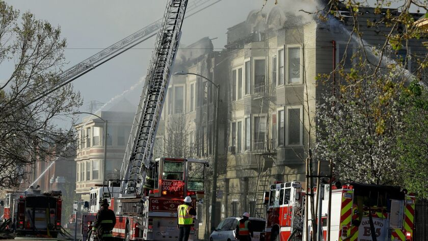 Firefighters battle an early morning apartment fire Monday, March 27, 2017, in Oakland, Calif. (AP P