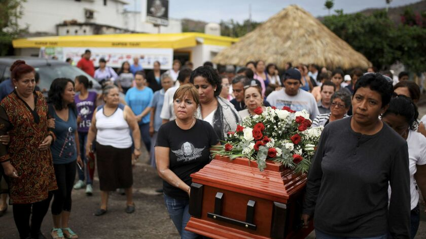 Members of the Colectivo Solecito search group carry the coffin of Pedro Huesca to a cemetery on March 8. The remains of Huesca, an investigator, were found in a mass grave and identified through DNA.