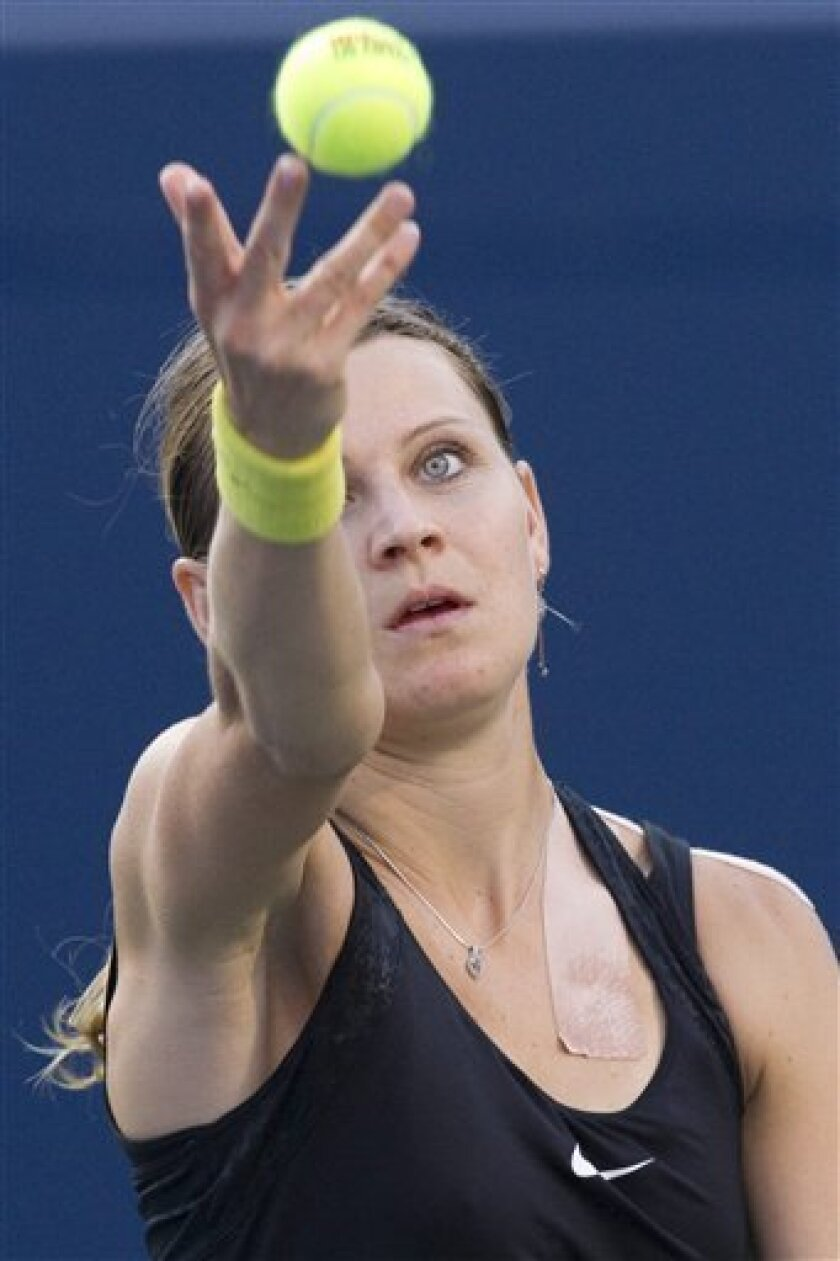 Czech Republic's Lucie Safarova throws the ball to serve to Serena Williams  during the Rogers Cup women's tennis tournament Friday, Aug. 12, 2011, in Toronto. (AP Photo/The Canadian Press, Chris Young)