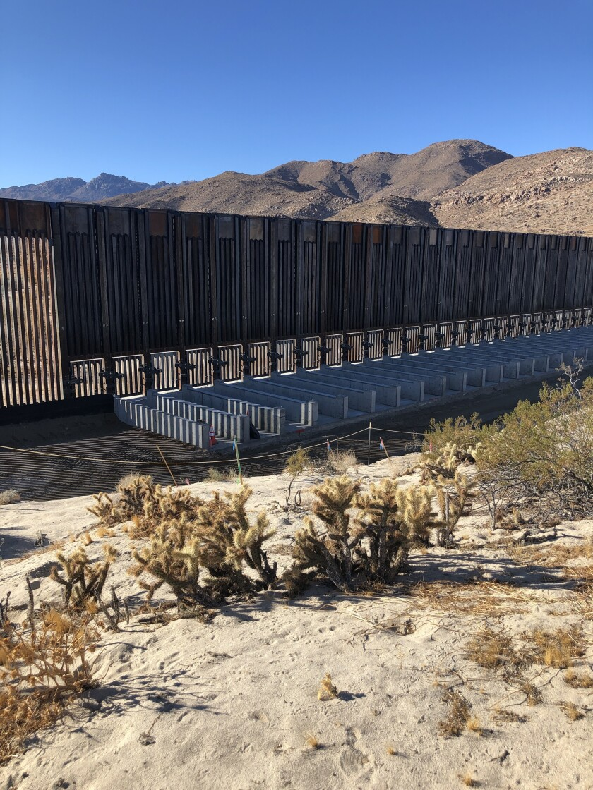 A large wash recently built into a new section of border wall outside Calexico, Calif., begun under President Trump.