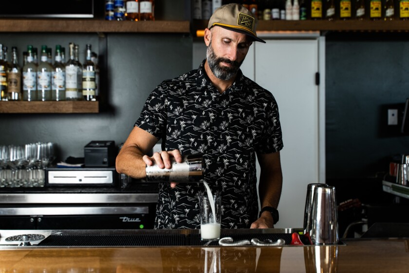 Christian Siglin pours a cocktail at Fernside in South Park.