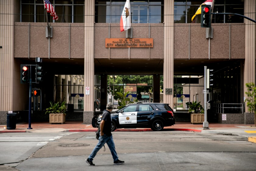 A San Diego Police Department vehicle is parked outside of San Diego City Hall on June 23, 2020 in San Diego, California.