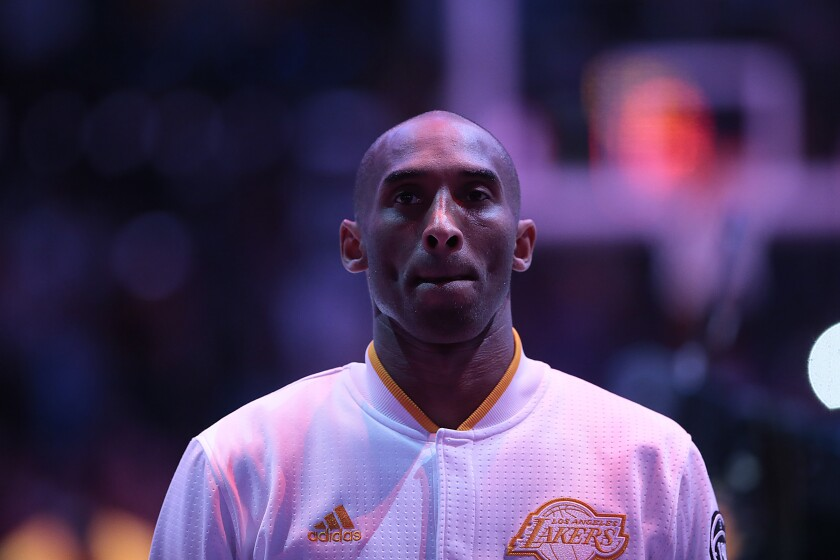 Lakers star Kobe Bryant stands for the national anthem before a game against the Indiana Pacers in November 2015.