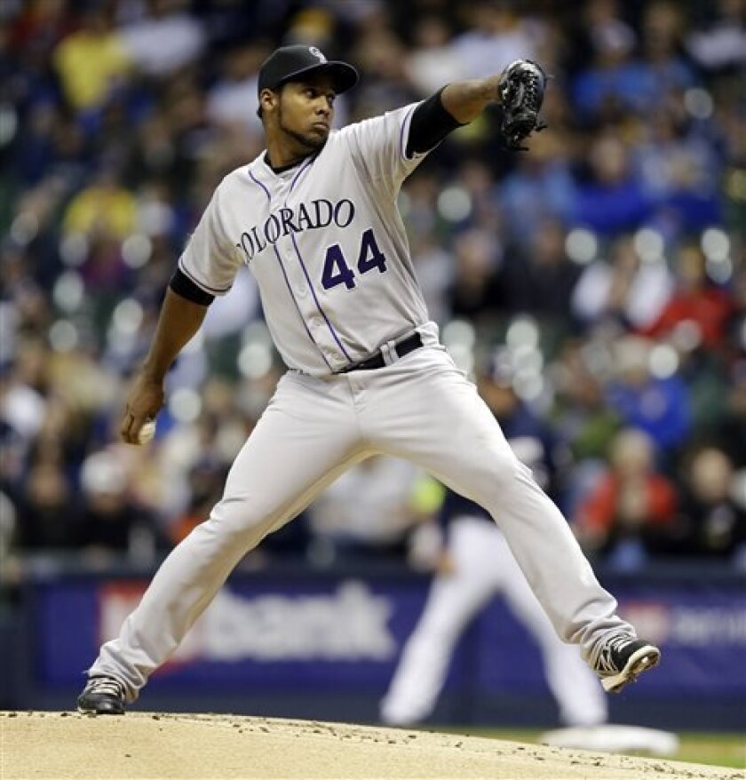 Colorado Rockies starting pitcher Juan Nicasio throws to the Milwaukee Brewers during the first inning of a baseball game, Wednesday, April 3, 2013, in Milwaukee. (AP Photo/Jeffrey Phelps)