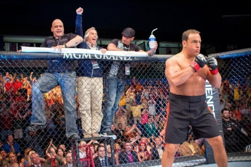 """From left to right, Bas Rutten, Henry Winkler, Mark DellaGrotte and Kevin James in a scene from the film """"Here Comes the Boom."""""""